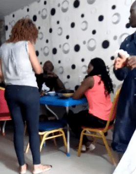 Lady slaps and pours hot soup on her cheating husband after she caught him in a restaurant with another woman (video)
