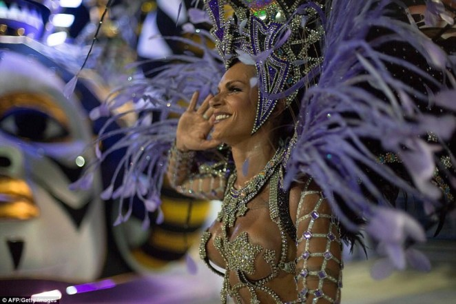 5a82e8a14b574 - 20 photos of Half-naked Brazilian dancers in sparkly G-strings & skimpy wears as they flood the street for Rio carnival (Photos)