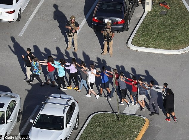 5a855660cda3b - Beloved track coach and teenage girl are named among the 17 tragic victims of Florida high school massacre (photos)