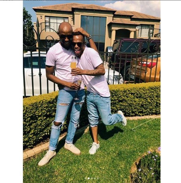 South African gay media personality, ?Somizi shows off his man as they step out in matching outfits (Photos)