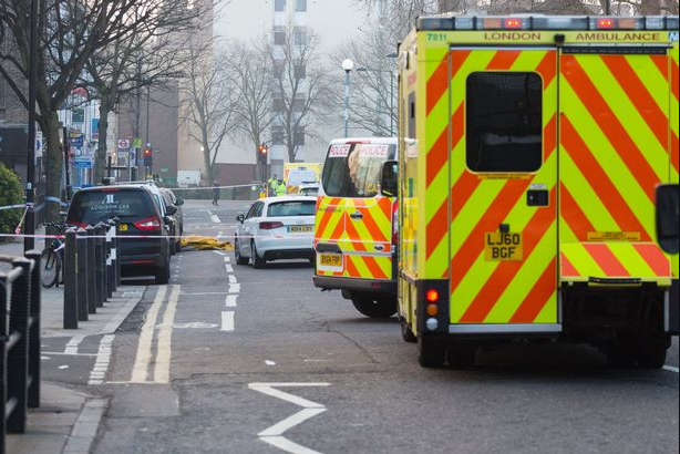 "Violent gang ""wearing bandanas hack 20-year-old to death with samurai sword"" in middle of road hours after teenager was also murdered"