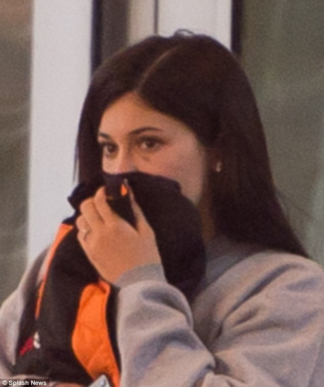 Is everything okay? Kylie Jenner sparks abuse rumours after she displays black eye while leaving a Miami hotel with beau Travis Scott (Photos)