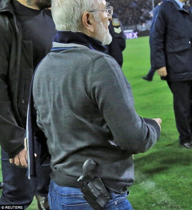 Photos: Football chairman confronts referee on the pitch with a gun in his belt, tells him
