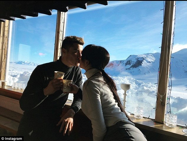 Photos: Cristiano Ronaldo shares a kiss with girlfriend Georgina during snow hiking date