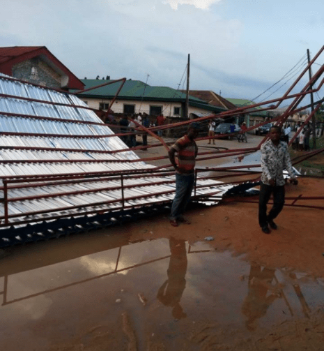 Recently installed Redeemed church roof is blown off by wind and destroys properties and power poles
