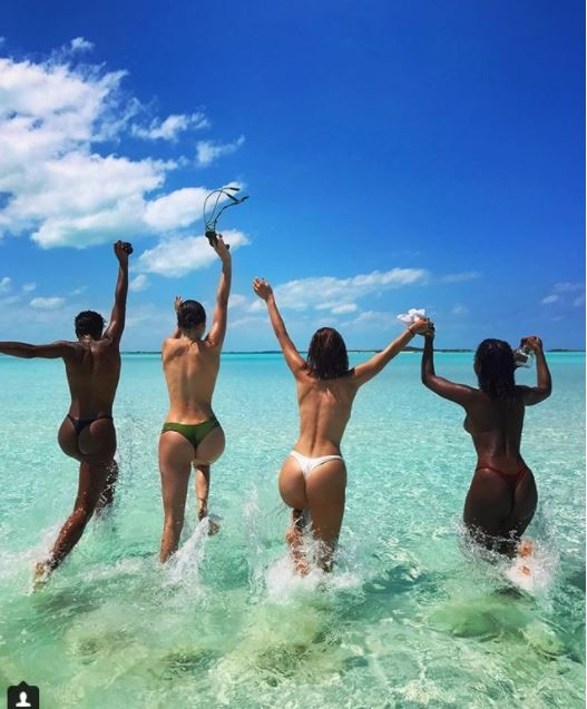 Kendall Jenner, Bella Hadid, Justine Sky, Renell Medrano & Hailey Baldwin strip off their bikini tops as they take a dip in the sea (Photos)