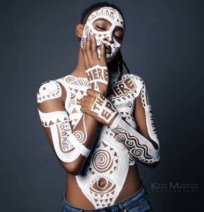 Ex BBN housemate, Marvis  poses completely topless with body paint in new photos