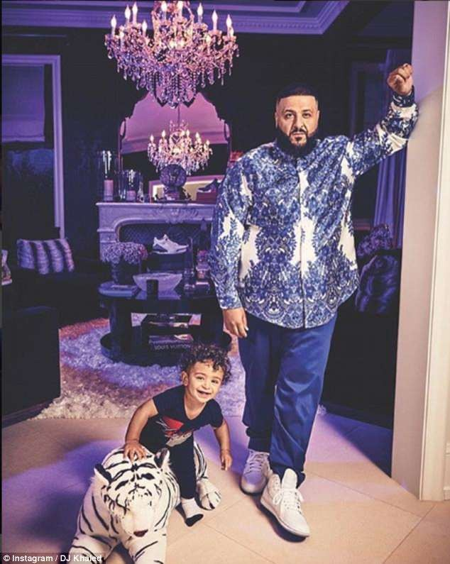 DJ Khaled and wife Nicole Tuck file to