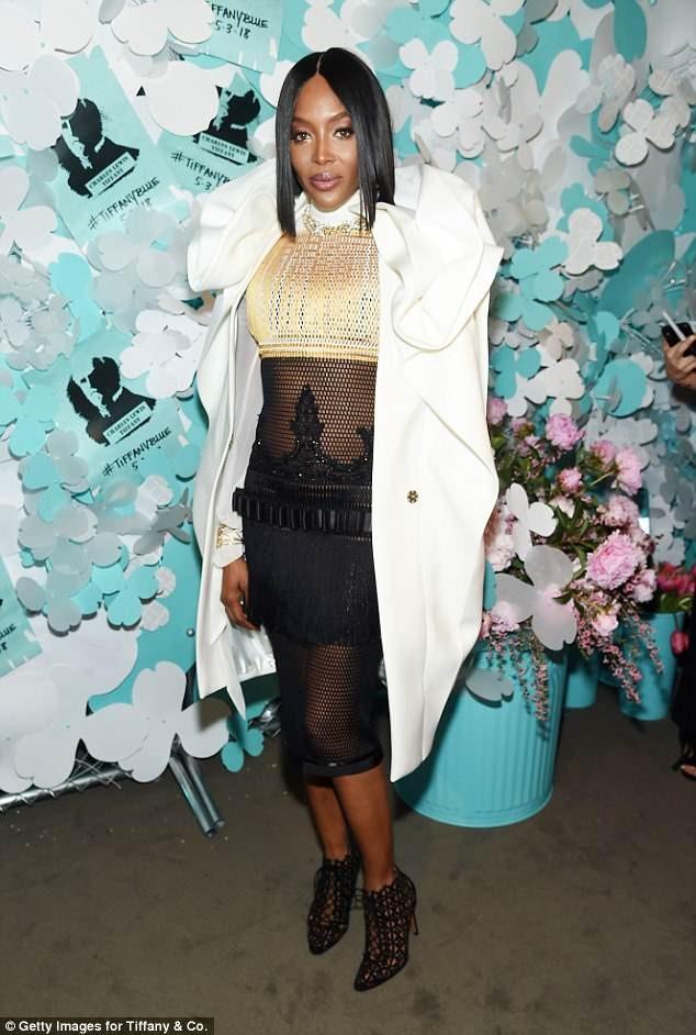 Naomi Campbell rocks daring fishnet dress and coat to glitzy Tiffany & Co. party in NYC (Photos)