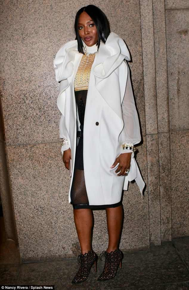 Naomi Campbell rocks daring fishnet dress and coat to glitzy Tiffany & Co. party in NYC (Photos)