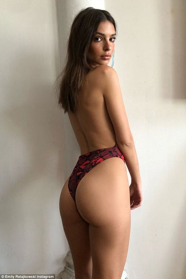 Emily Ratajkowski poses topless and flaunts her pert derriere in sultry photos