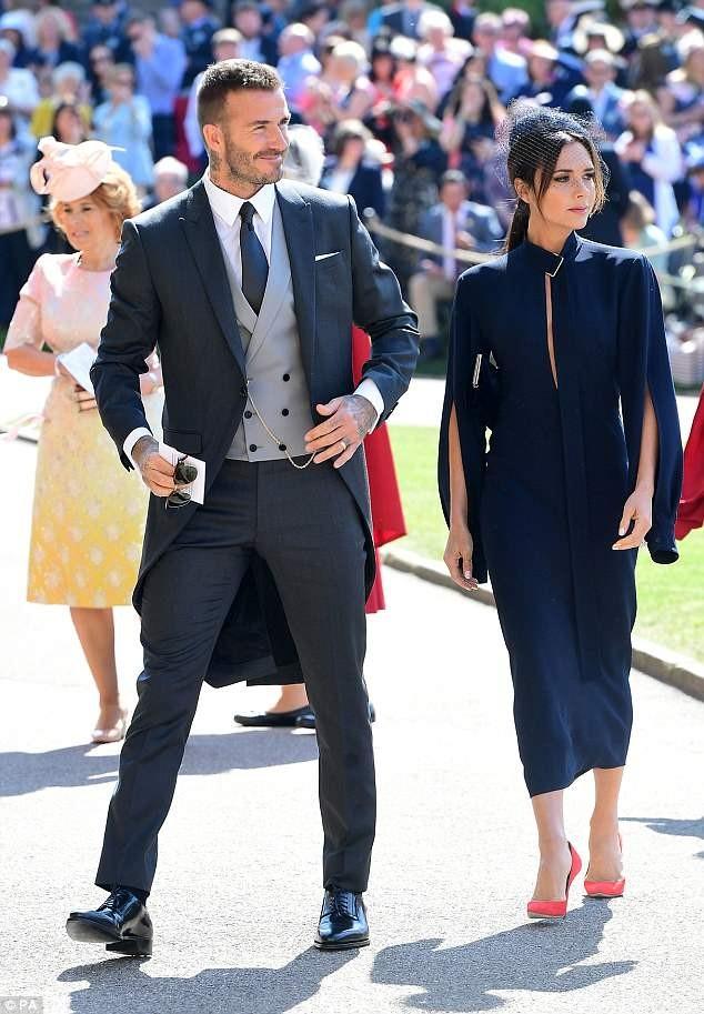 #RoyalWedding: Victoria Beckham stuns in navy blue dress as she joins husband David for Prince Harry and Meghan Markle