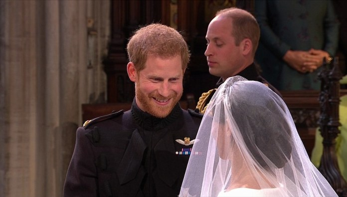 Tearful Prince Harry is bowled over by bride Meghan as she arrives in a spectacular dress