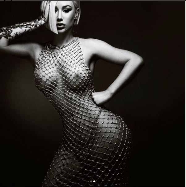 5b014ef2afe43 - Iggy Azalea shares more nude photos of herself wearing only a beaded mesh dress