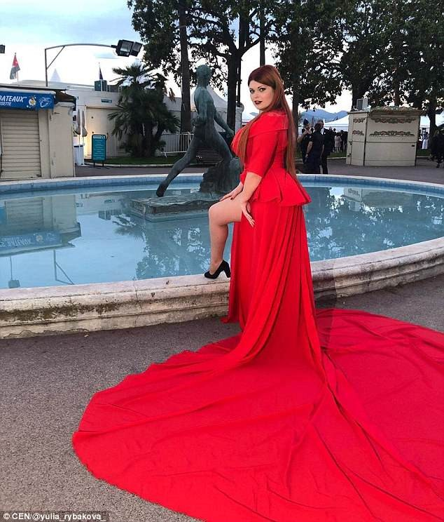 Russian plus size model suffers major embarrassment after her skirt is ripped from her body, leaving her underwear exposed at Cannes Festival (Photos/Video)