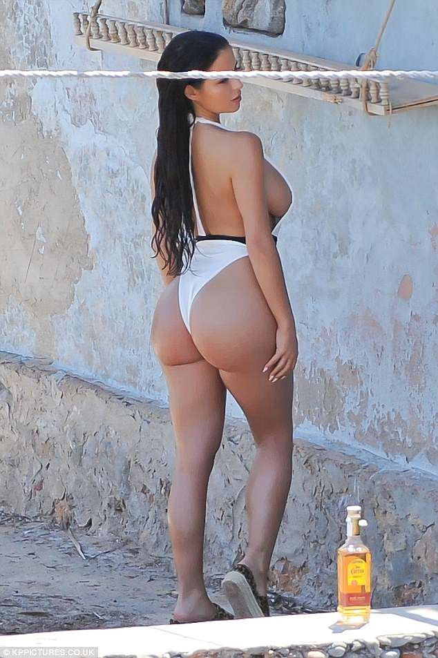 Demi Rose flaunts her sensational physique in barely-there swimsuit for Ibiza photoshoot (Photos)