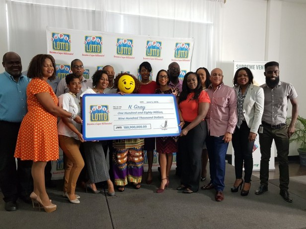Lol. Jamaican lottery winner shows up in a mask to claim her  $180 Million prize (Photos)