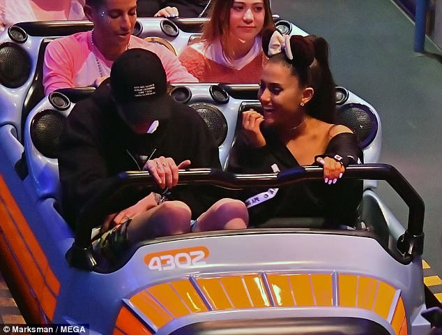 Ariana Grande flashes her huge engagement ring and shares a kiss with fiance Pete Davidson at Disneyland (Photos/Video)
