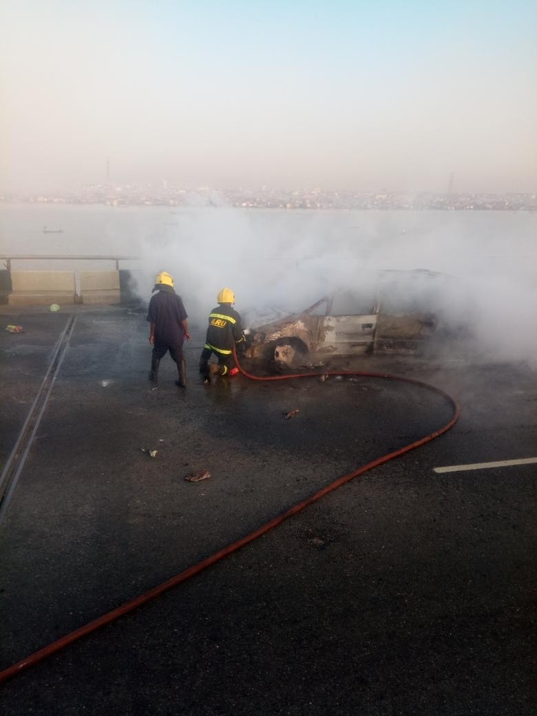 Photos: LASEMA puts out the burning mini van on Third Mainland Bridge
