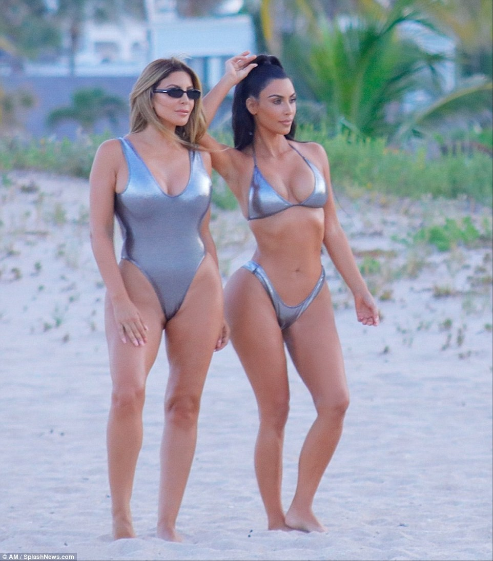 Kim Kardashian flaunts her banging body in sexy silver bikini as she poses in Miami beach (Photos)