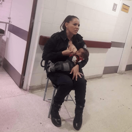 Police officer hailed a hero after she was snapped breastfeeding malnourished baby