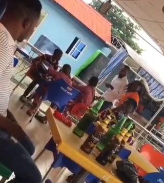 Nigerian bar manager walks out underage boys who were drinking beer in his bar (video)