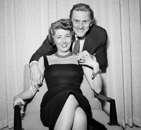 Spartacus actor Kirk Douglas, 101, and wife Anne Buydens, 99, remain inseparable after 64 years of marriage as they are pushed along in wheelchairs