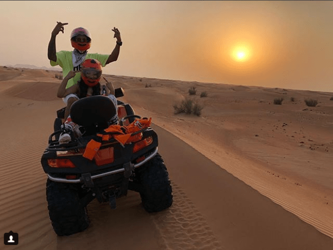 Check out photos of Nicki Minaj and her rumoured new boo, Lewis Hamilton riding together on an ATV in Dubai?