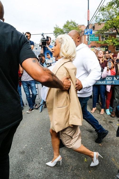 Cardi B pictured all smiles as she leaves police precinct after turning herself in