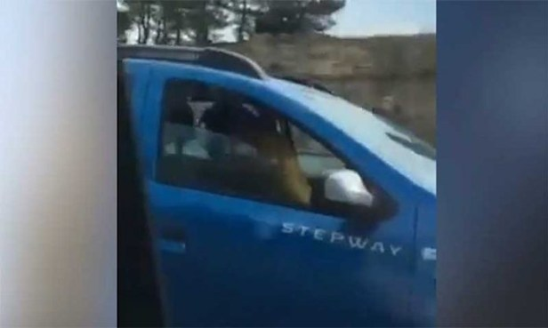 Shocking moment couple are caught having sex while driving down the middle lane of a Spanish motorway (Video)