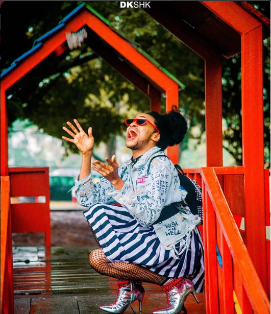 Denrele Edun rocks mini-skirt and sleeveless top in new photos