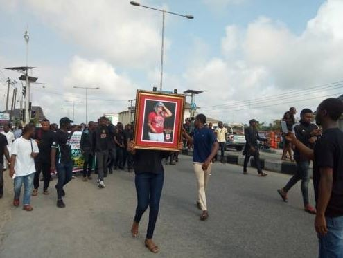Students of Niger Delta University protest the killing of a 16-year-old colleague by cultists