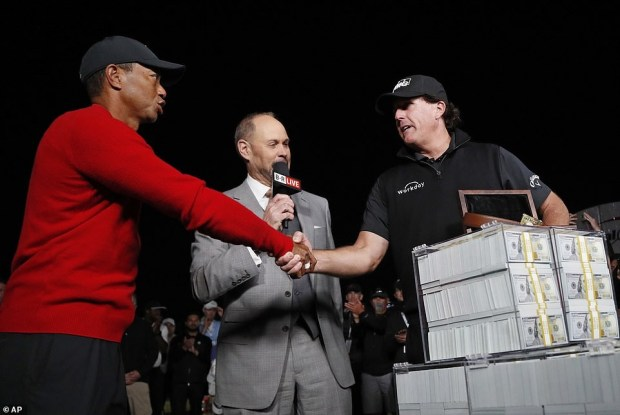 See photos of the cash price of $9m Golf legend Tiger Woods lost to Phil Mickelson in an exhibition match?