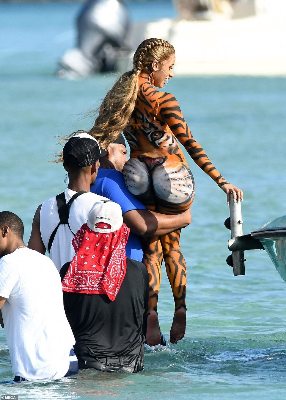 Cardi B twerks on Miami beach in tiger costume after failing to appear in court over a fight at New York club (Photos)