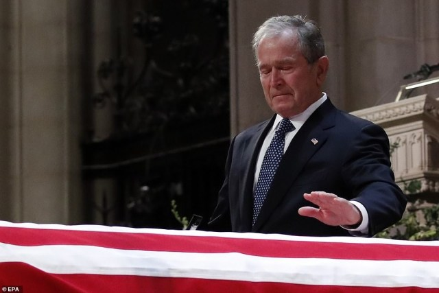 Former US president George W. Bush breaks down in tears as he says farewell to his late father George H.W. Bush at his funeral service. (Photos)