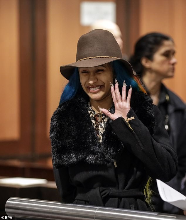 Newly single Cardi B ?sticks out her tongue as she finally appears in court over a fight?at a strip club (Photos)