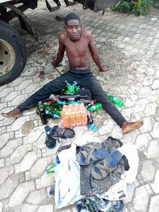 Photos: Suspected cultist nabbed in Bayelsa for burglary and robbery, forced to drink stolen beer