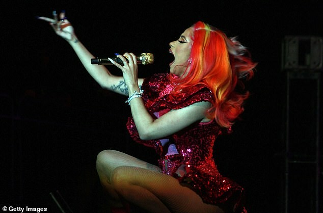 Cardi B flashes her curvy backside in a racy red bodysuit as she performs in Puerto Rico (Photos)