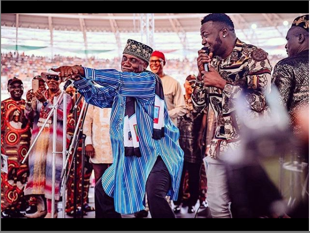 Caption this photo of Minister of transportation, Rotimi Amaechi and MC Galaxy on stage