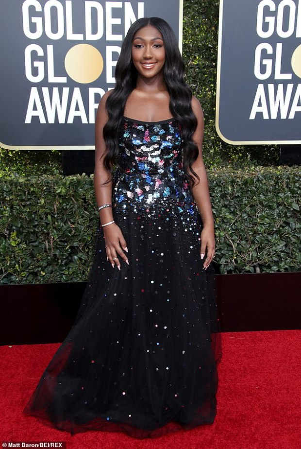 Idris Elba accompanies his 17-year-old daughter Isan to the stage as she makes her debut as Golden Globes