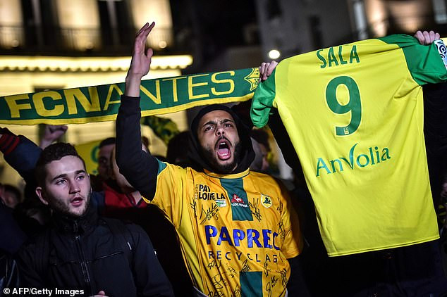 Fans hold a vigil in France for Argentine striker Emiliano Sala after his plane vanishes over Channel Islands?(Photos)