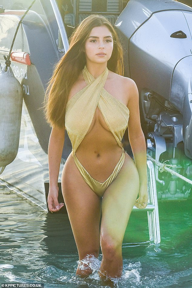 Demi Rose flaunts her incredible curves in a gold crossover swimsuit as she continues her exotic Thailand trip (Photos)