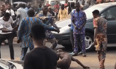 Moment suspected kidnapper is stripped, beaten, paraded naked and had tyre thrown round his neck (video)