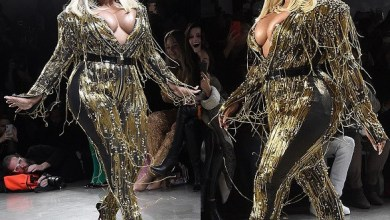 Rapper Lil' Kim puts on a very busty display in a plunging gold jumpsuit as she performs at New York Fashion Week (Photos)