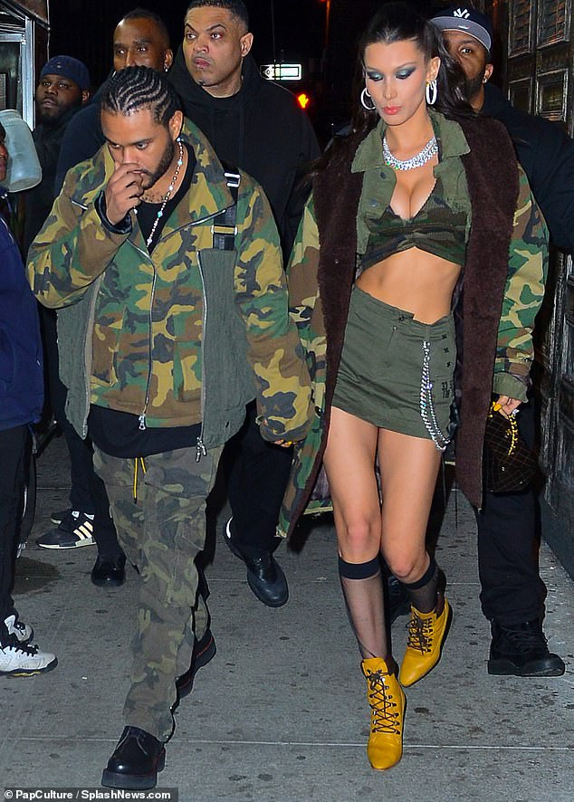 Bella Hadid flaunts cleavage in racy crop top as she steps out with her beau The Weeknd for his 29th camo themed birthday (Photos)
