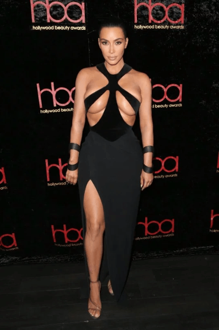 Kim Kardashian puts her boobs on display in vintage Mugler gown that resembles Jodie Marsh?s iconic boob belt outfit