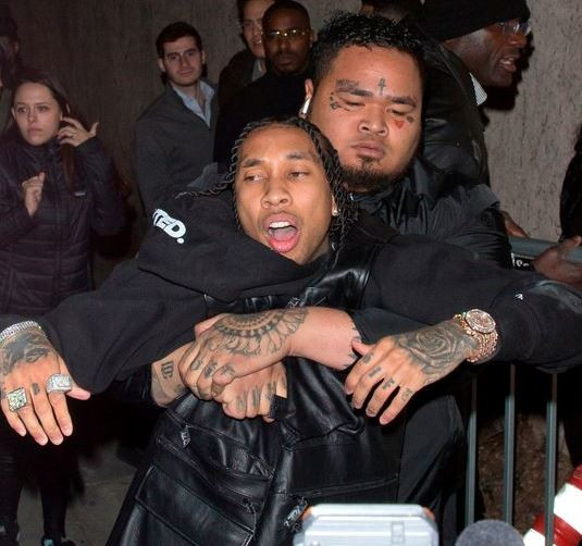 Photos: Tyga reaches for a gun after he was violently dragged out of Floyd Mayweather