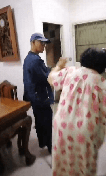 Terrifying moment python slithers across bedroom before biting grandma, 75, is caught on CCTV (video)