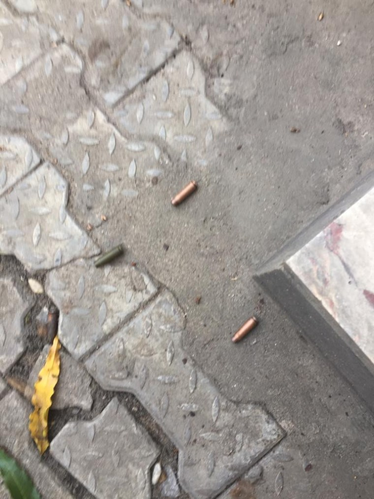 Photos of bloodstains and bullet holes from the