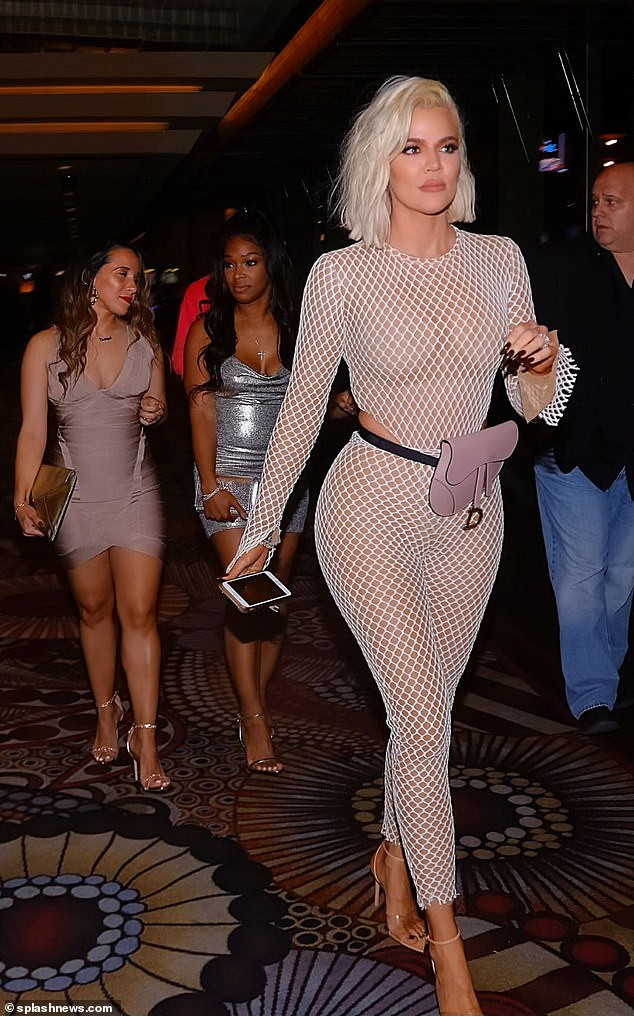 Khloe Kardashian flaunts her curves in a skintight fishnet catsuit as she steps out for her best friend